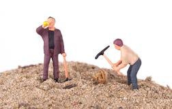 Trabajadores miniatura con las piquetas Imagen de archivo libre de regalías