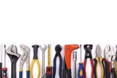 Trabaje las herramientas en el fondo blanco Foto de archivo libre de regalías