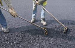 Trabajo de la gente para pavimentar Imagen de archivo