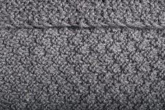 Trabajo de punto en los detalles para la tela gris, materia textil Imágenes de archivo libres de regalías