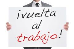 Trabajo del al de Vuelta, de nuevo a trabajo en español Imágenes de archivo libres de regalías