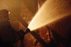 Trabajo del bombero imagen de archivo libre de regalías