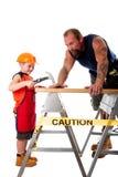 Trabajo del carpintero del padre y del hijo Fotos de archivo