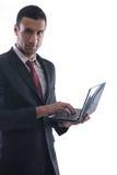 Trabajo del hombre de negocios sobre la mini computadora portátil Imagen de archivo