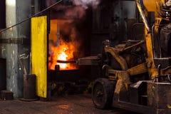 Trabajo duro en una fábrica Foto de archivo libre de regalías