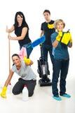 Trabajo en equipo acertado de los trabajadores de la limpieza Imágenes de archivo libres de regalías