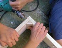 Trabajo en equipo - carpintería Imágenes de archivo libres de regalías