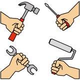 Trabajo en equipo de las manos con las herramientas