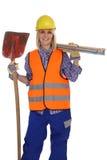 Trabajo femenino joven de la mujer del trabajador de construcción aislado Imagen de archivo
