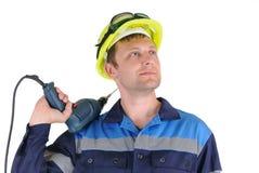 Trabalhador atrativo dos homens novos com uma broca isolada Foto de Stock Royalty Free