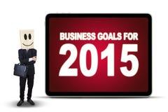 Trabalhador com cara e objetivos de negócios do smiley Fotografia de Stock