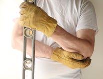 Trabalhador com cotovelo dorido Imagens de Stock Royalty Free