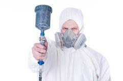 Trabalhador com injetor do airbrush, foco seletivo Foto de Stock