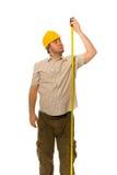 Trabalhador com medida Foto de Stock Royalty Free