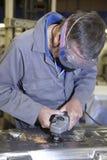 Trabalhador com moedor de ângulo Fotografia de Stock