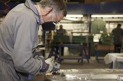 Trabalhador com moedor de ângulo Foto de Stock Royalty Free