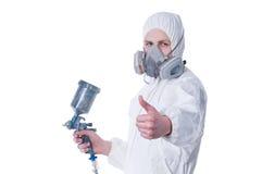 Trabalhador com o injetor do airbrush que dá os polegares acima Imagens de Stock Royalty Free