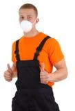 Trabalhador com uma máscara de poeira Fotografia de Stock Royalty Free