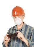 Trabalhador com vidros, capacete e respirador Imagem de Stock
