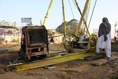 Trabalhador da construção com máquina Foto de Stock