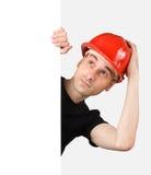 Trabalhador da construção com um sinal em branco Fotografia de Stock Royalty Free