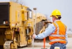 Trabalhador da construção da estrada da estrada Foto de Stock Royalty Free