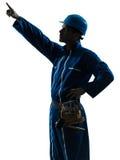 Trabalhador da construção do homem que aponta a silhueta Imagens de Stock Royalty Free