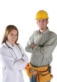Trabalhador da construção e enfermeira Fotos de Stock Royalty Free