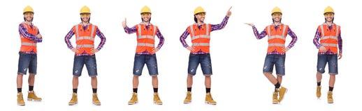 Trabalhador da construção novo no capacete e resumos isolados no branco Imagem de Stock