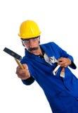 Trabalhador da construção pateta que mostra suas ferramentas Imagens de Stock