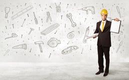 Trabalhador da construção que aplana com ícones tirados mão da ferramenta Fotografia de Stock Royalty Free
