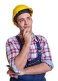 Trabalhador da construção que faz planos para o futuro Foto de Stock Royalty Free