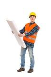 Trabalhador da construção que guarda o projeto de papel. Imagem de Stock