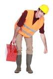 Trabalhador da construção que levanta algo Imagem de Stock Royalty Free