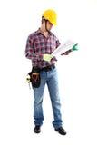 Trabalhador da construção que olha modelos Fotografia de Stock