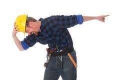 Trabalhador da construção que tittering Imagens de Stock