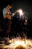 Trabalhador da soldadura na fábrica fotografia de stock royalty free