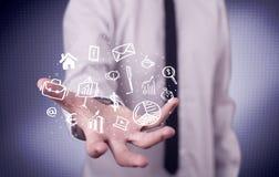 Trabalhador de escritório com ícones tirados na palma Imagens de Stock