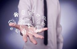 Trabalhador de escritório com ícones tirados na palma Fotografia de Stock