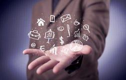 Trabalhador de escritório com ícones tirados na palma Foto de Stock