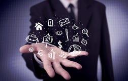 Trabalhador de escritório com ícones tirados na palma Fotos de Stock Royalty Free