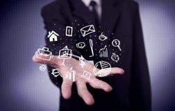 Trabalhador de escritório com ícones tirados na palma Fotografia de Stock Royalty Free