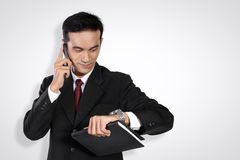 Trabalhador de escritório ocupado, no branco foto de stock