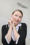 Trabalhador de escritório vestido como um anjo imagens de stock royalty free