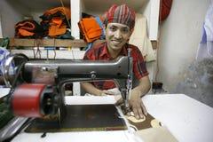 Trabalhador de matéria têxtil Fotografia de Stock Royalty Free
