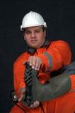 Trabalhador de mina nos carregadores Fotografia de Stock Royalty Free