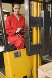 Trabalhador do armazém no forklift Fotos de Stock Royalty Free