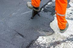 Trabalhador do asfalto Fotografia de Stock