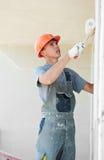 Trabalhador do plasterer da fachada do construtor imagens de stock