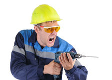 Trabalhador dos homens da expressão com uma broca isolada Foto de Stock